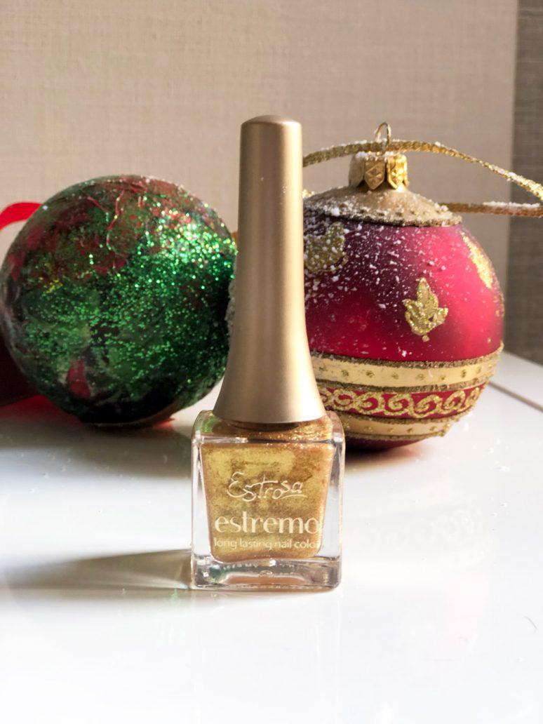 immagine dello smalto oro glitter Estremo di Estrosa