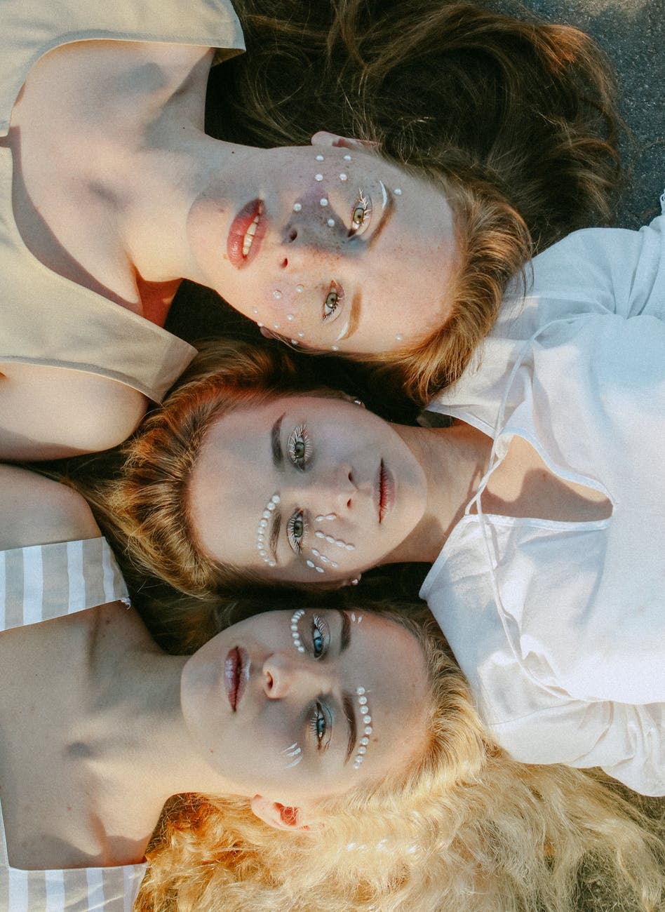 top view photo of women with face art