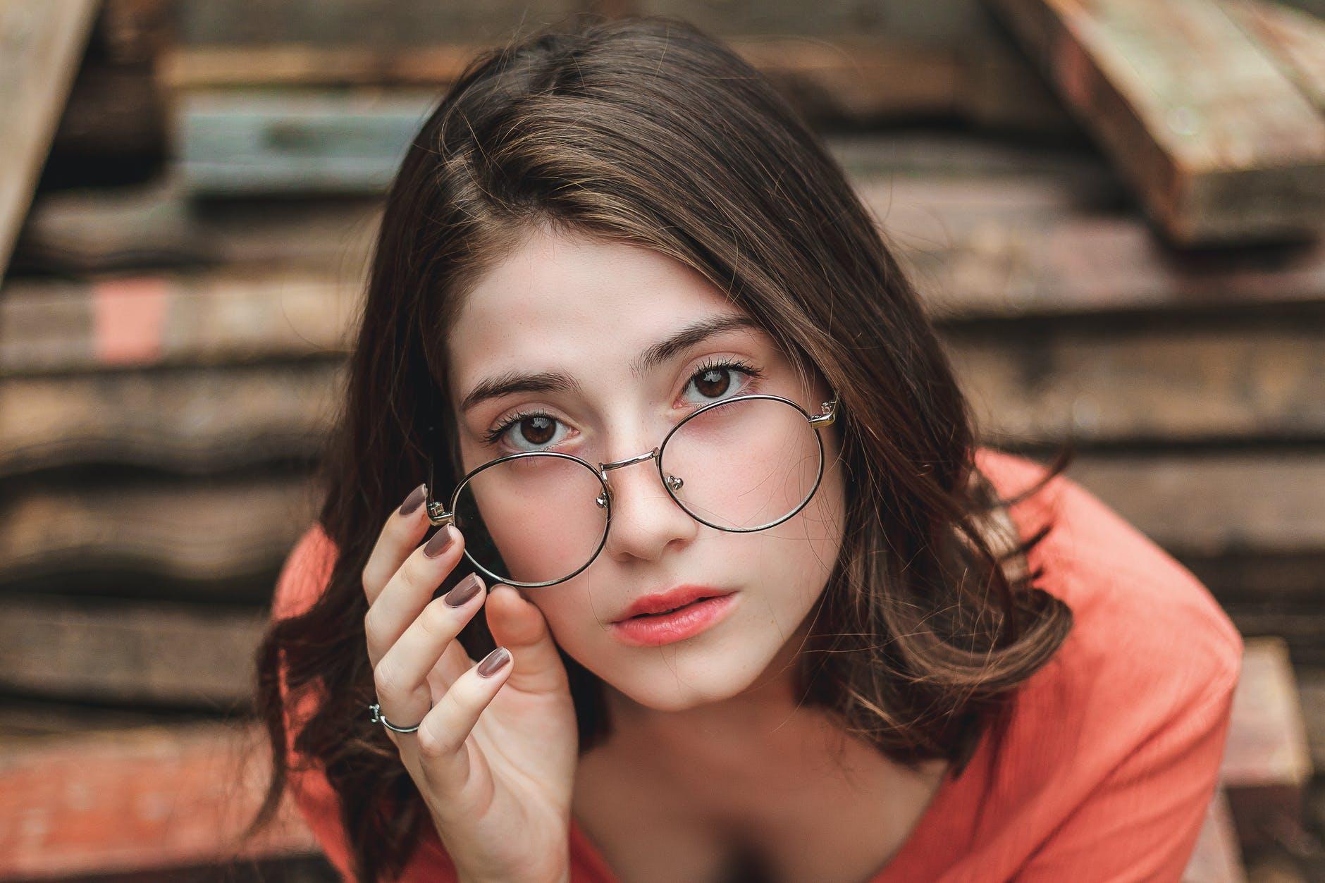 sitting woman wearing eyeglasses