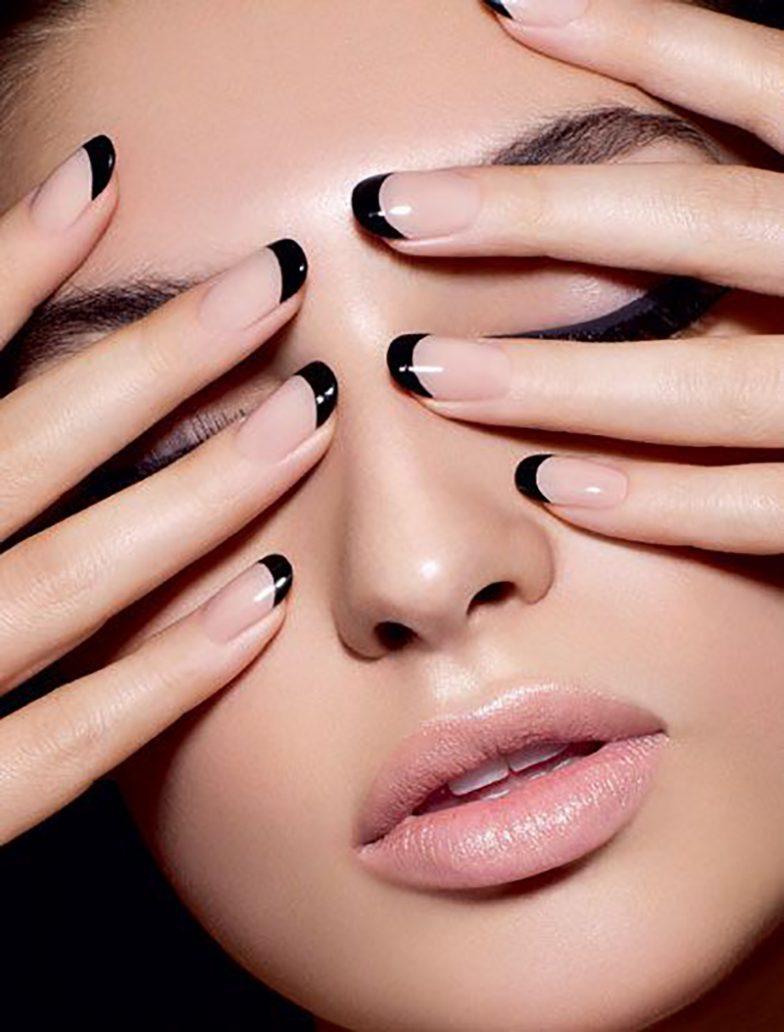 Foto di nail art con smalto nero e rosa